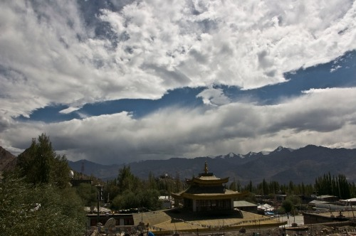 Everchanging Cloud formation against temple and Mountain backdrop